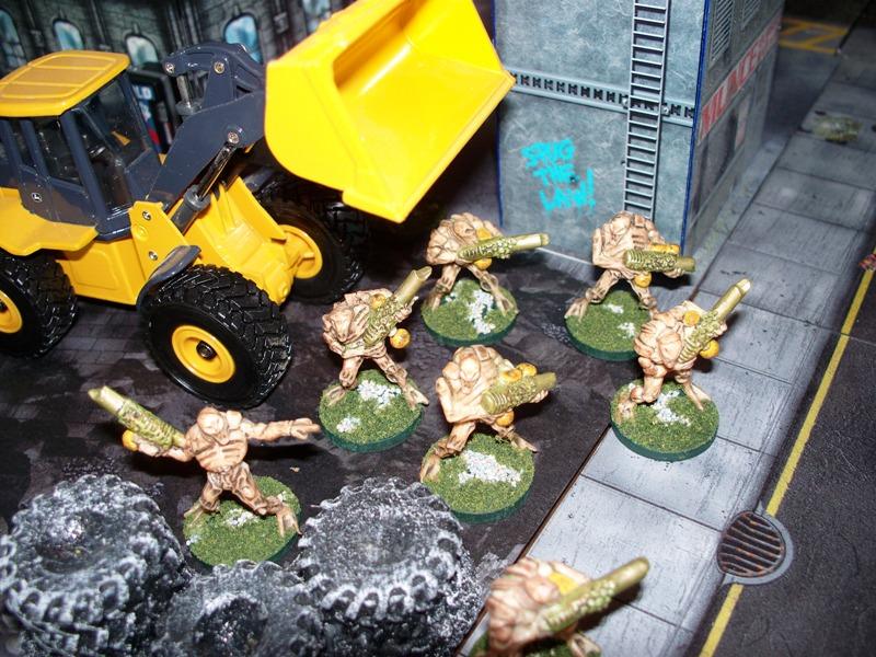 Marro warriors take up firing positions